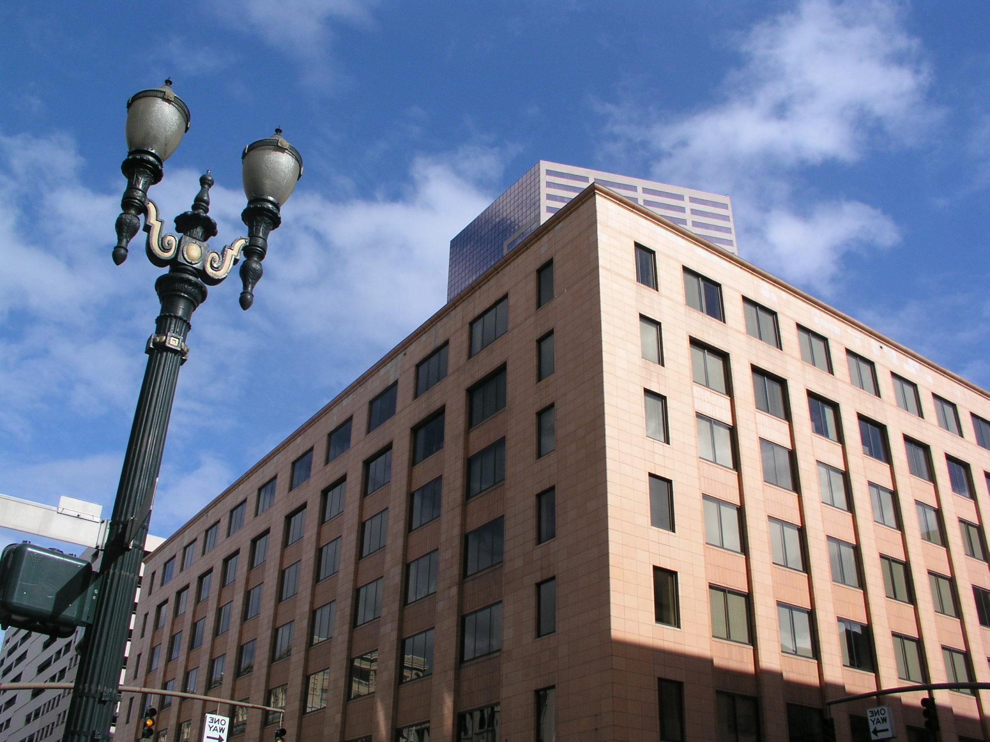 The Lincoln Building, a seven-story office building in downtown Portland, Ore. The US Bancorp Tower is visible behind it.