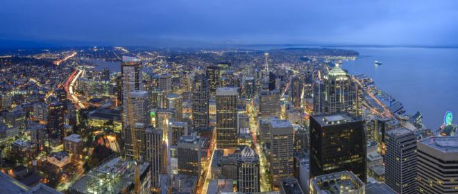 An aerial of Seattle's downtown lights at night